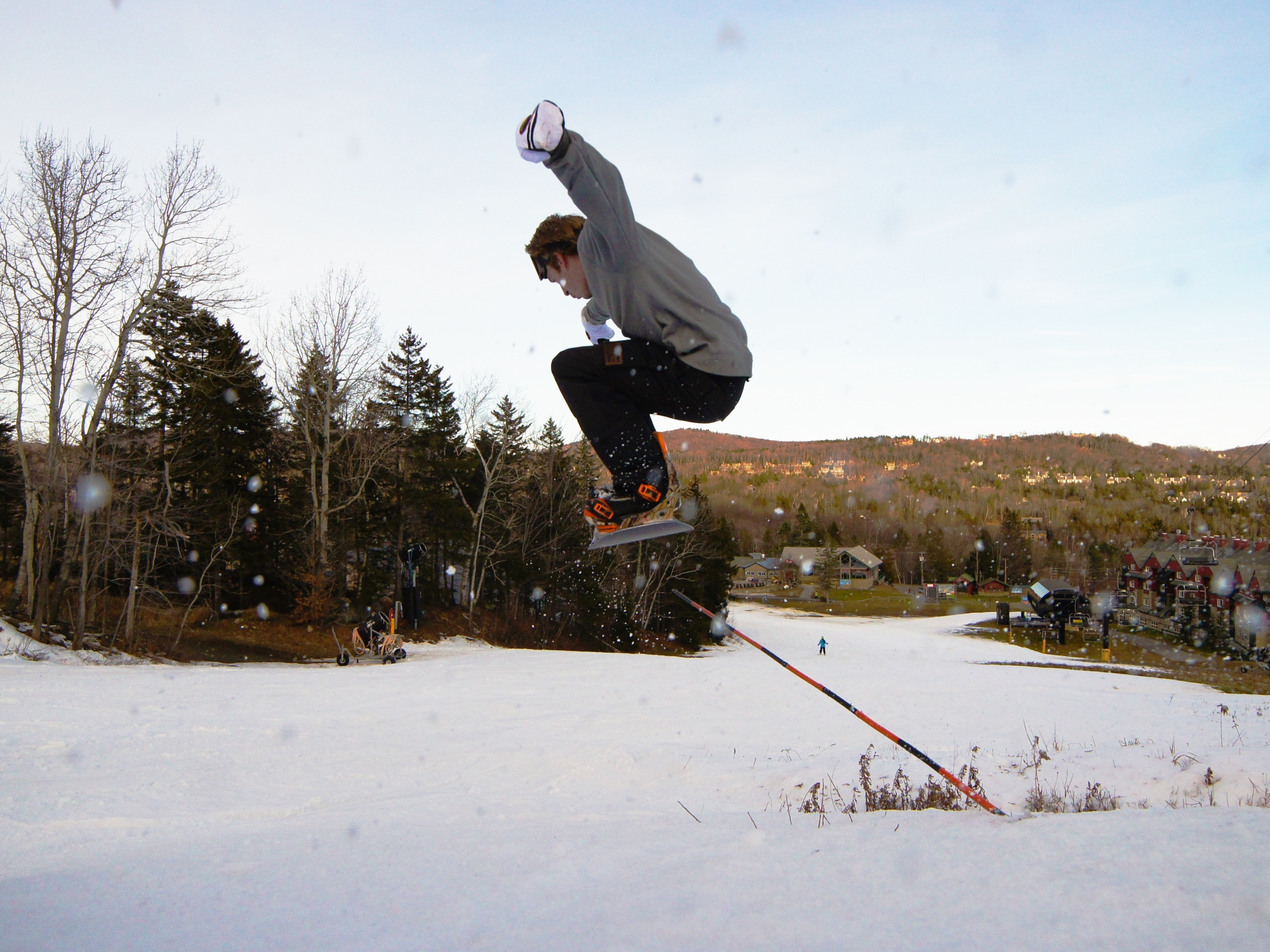 snowboarder hitting a pole jam