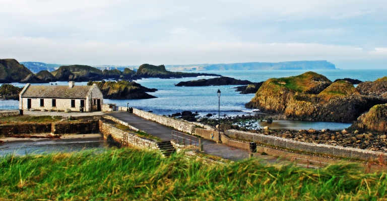 The irish coastline and cottage